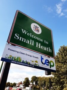 """TEP sign underneath """"Welcome to Small Heath"""" road s"""